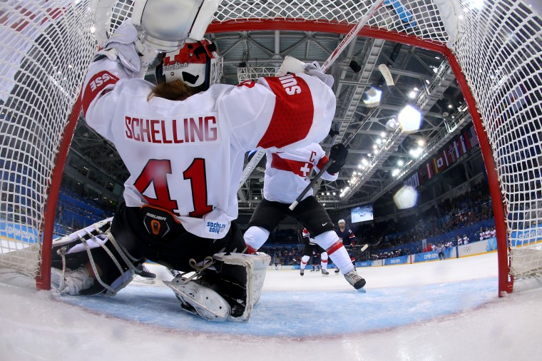 Florence Schelling #41 of Switzerland falls intot the goal during the Women's Ice Hockey Preliminary Round Group A game against United States on day three of the Sochi 2014 Winter Olympics at Shayba Arena on February 10, 2014 in Sochi, Russia. (Photo by Martin Rose/Getty Images)