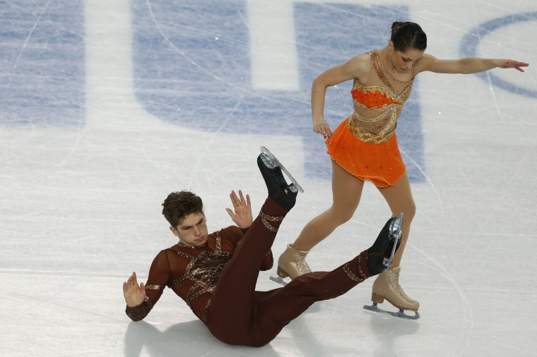 Italy's Nicole Della Monica and Italy's Matteo Guarise fall in the Figure Skating Pairs Short Program at the Iceberg Skating Palace during the 2014 Sochi Winter Olympics on February 11, 2014. (Adrian Dennis/AFP/Getty Images)
