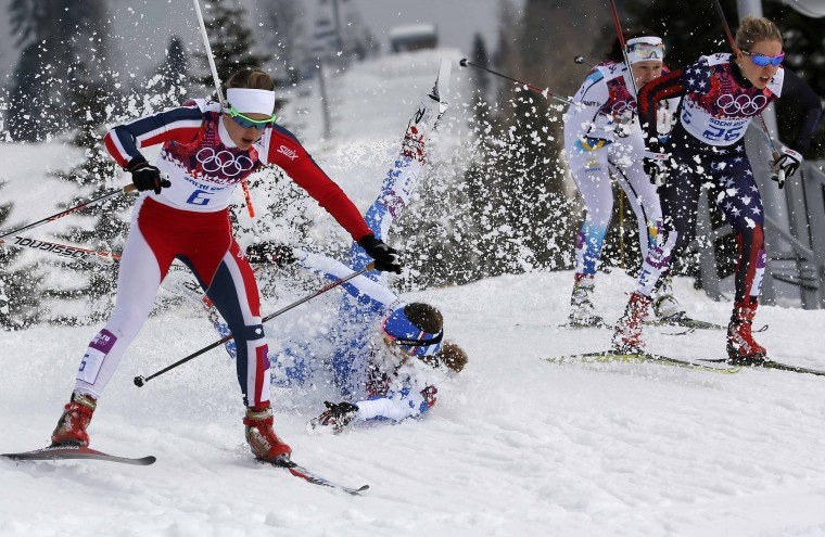 Italy's Greta Laurent (2nd L) crashes as Norway's Ingvild Flugstad Oestberg (L), Sweden's Britta Johansson Norgren (top R) and Ida Sargent of the U.S. ski during the women's cross-country sprint quarterfinal at the Sochi 2014 Winter Olympic Games in Rosa Khutor February 11, 2014. (REUTERS/Stefan Wermuth)