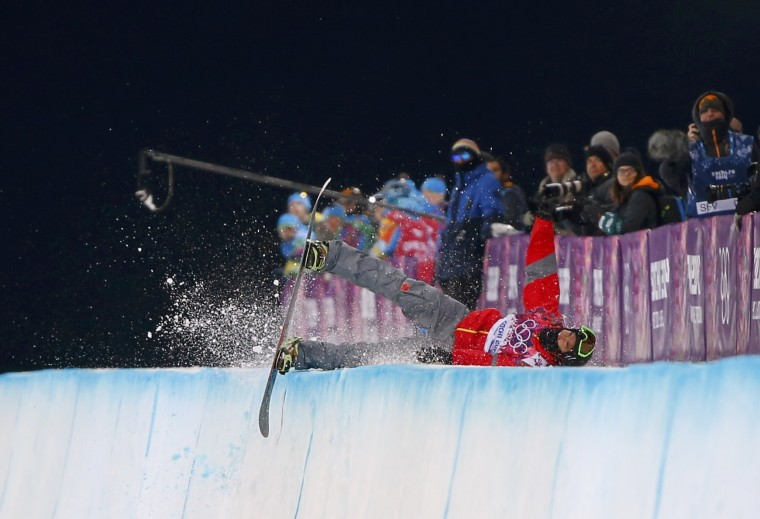 China's Shi Wancheng crashes during the men's snowboard halfpipe semi-final event at the 2014 Sochi Winter Olympic Games, in Rosa Khutor February 11, 2014. (REUTERS/Mike Blake)