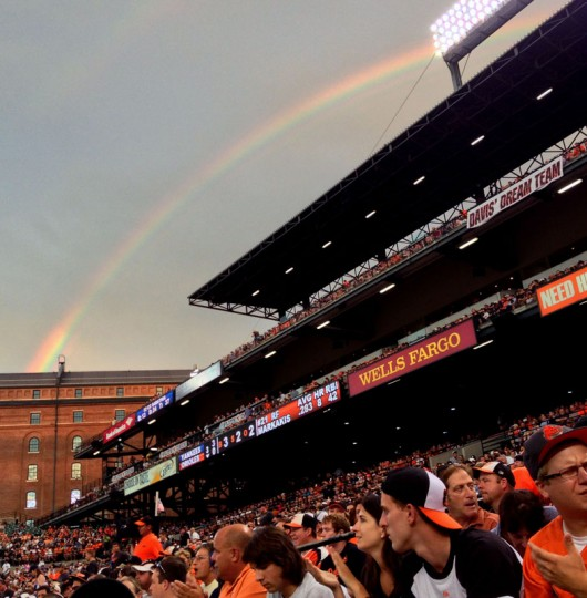 A rainbow appears over Camden Yards during the middle inning of Baltimore's game against New York June 28, 2013. (Gene Sweeney Jr./Baltimore Sun Staff)