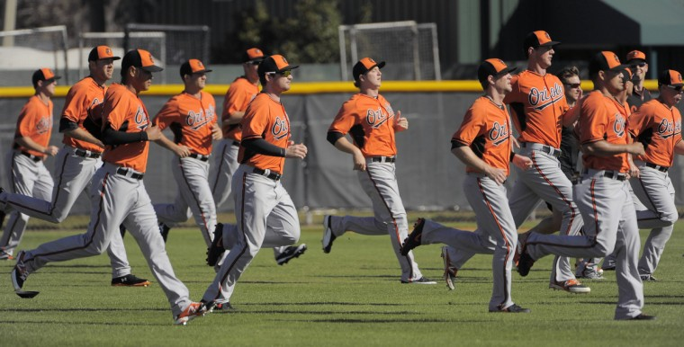 Orioles players loosen up on the day that position players report at the club's spring training facility. (Karl Merton Ferron/Baltimore Sun)