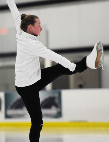 Erin Coyne holds up a leg while she spins. (Jon Sham/BSMG)