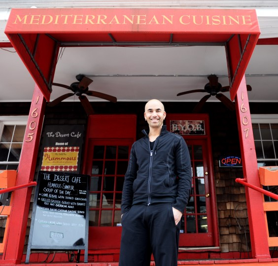 Blake Wollman, owner of Desert Cafe in the Mount Washington Village, poses for a photo in front of the business on Friday, Jan. 31, 2014. (Jon Sham/BSMG)
