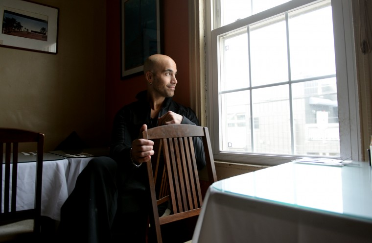 Blake Wollman, owner of Desert Cafe in the Mount Washington Village, looks out the window in the second store of his restaurant on Friday, Jan. 31, 2014. Wollman's Wild Pea Hummous business has been very successful, while business at the cafe has been slow due partly to competition in the village from other restaurants. (Jon Sham/BSMG)