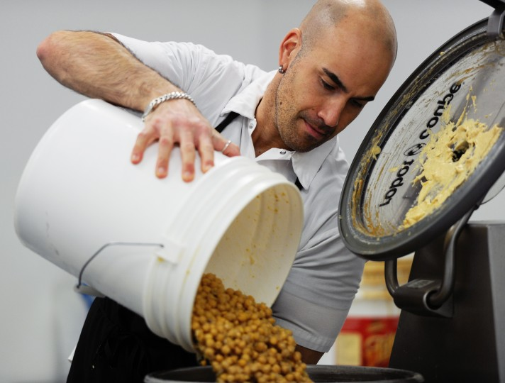 Thousands of chick peas go into every batch of hummus made by Blake Wollman, pictured, and his Wild Pea Hummous company, run out of an office space in Randallstown. Monday, Feb. 3, 2014. (Jon Sham/BSMG)