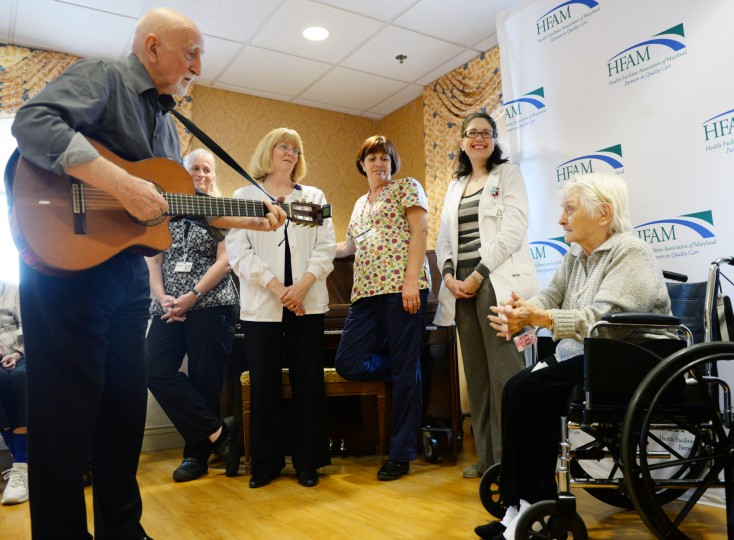 "Stella Maris nursing home resident Leona Deares, right, sings along with Dominic Chianese, known for playing Corrado John ""Uncle Junior"" Soprano in HBO's The Sopranos, on Monday, Feb. 3, 2014. Chianese appeared as part of his Joy Through Art Foundation, which received a donation from the Heath Facilities Association of Maryland. (Jon Sham/BSMG)"