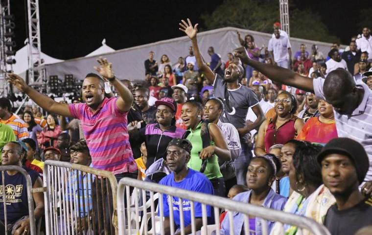 Fans react while watching watch the finals of the national stick fighting competition in San Fernando. (Andrea De Silva/Reuters photo)