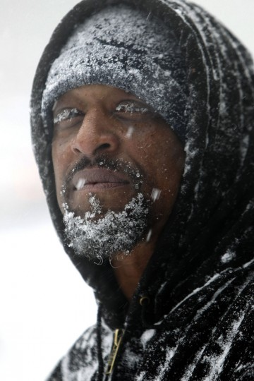 Snow clings to Turron Williams' beard and eyelashes in Raleigh, N.C. (Travis Long/Raleigh News & Observer/MCT)