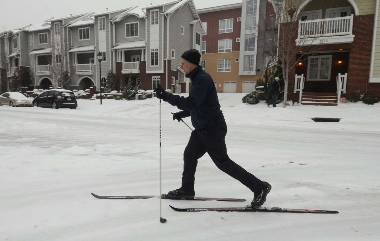 Peter Phillips uses his cross-country skies to navigate the frozen streets in Charlotte, N.C. (Robert Lahser/Charlotte Observer/MCT)