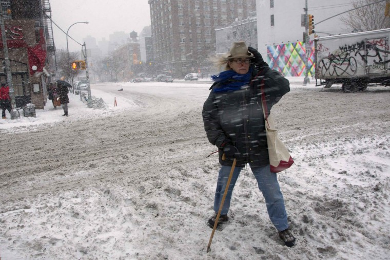 A commuter tries to cross Bowery through heavy snow in Manhattan, New York. (REUTERS/Andrew Kelly)