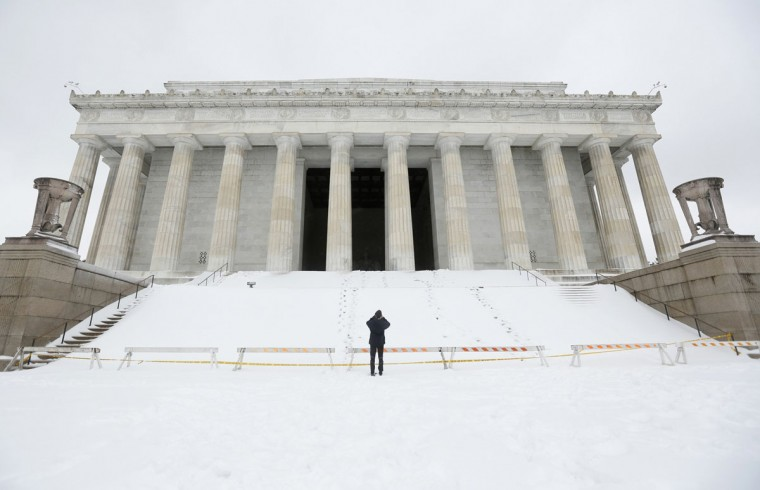 A man photographs the snow covered Lincoln Memorial in Washington. (REUTERS/Kevin Lamarque)