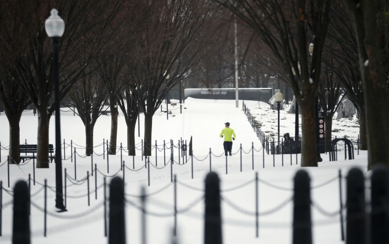 A jogger makes his way through the snow on the National Mall in Washington. (REUTERS/Kevin Lamarque)