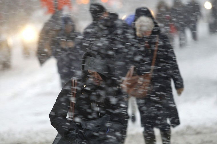 Commuters make their way through heavy snow in New York. (REUTERS/Joshua Lott)