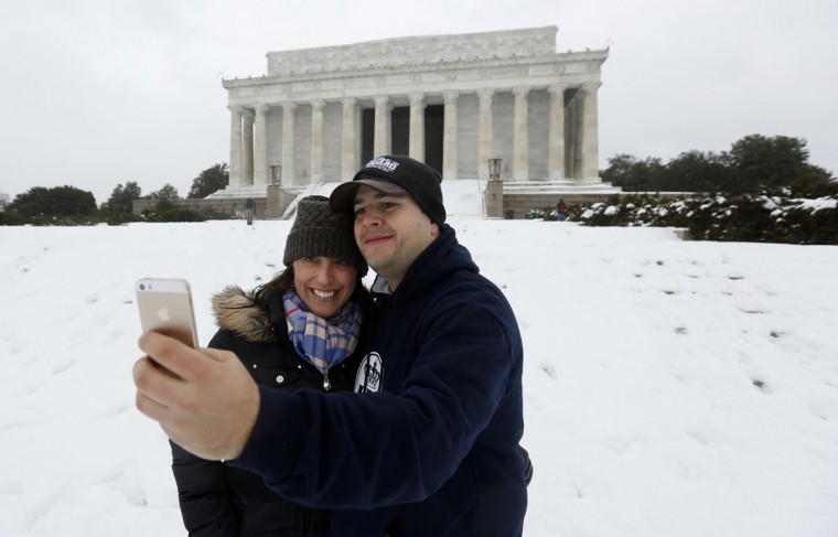 "A couple from Arlington, Va., take a ""selfie"" in front of the Lincoln Memorial in Washington. (REUTERS/Kevin Lamarque)"