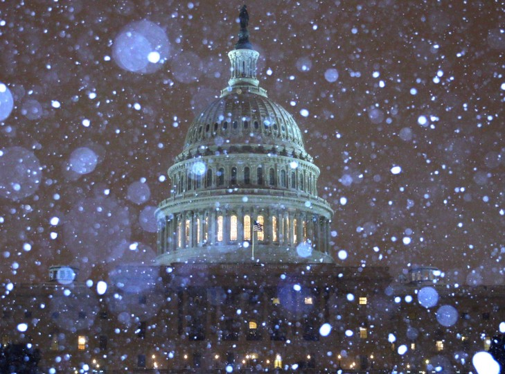 Snow falls in front of the U.S. Capitol building in Washington, DC. (Photo by Mark Wilson/Getty Images)