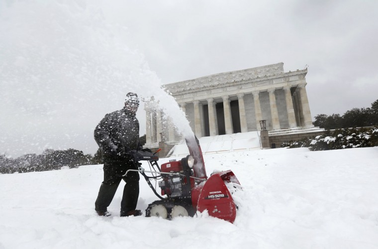 Snow is cleared from a walkway to the Lincoln Memorial in Washington. (REUTERS/Kevin Lamarque)
