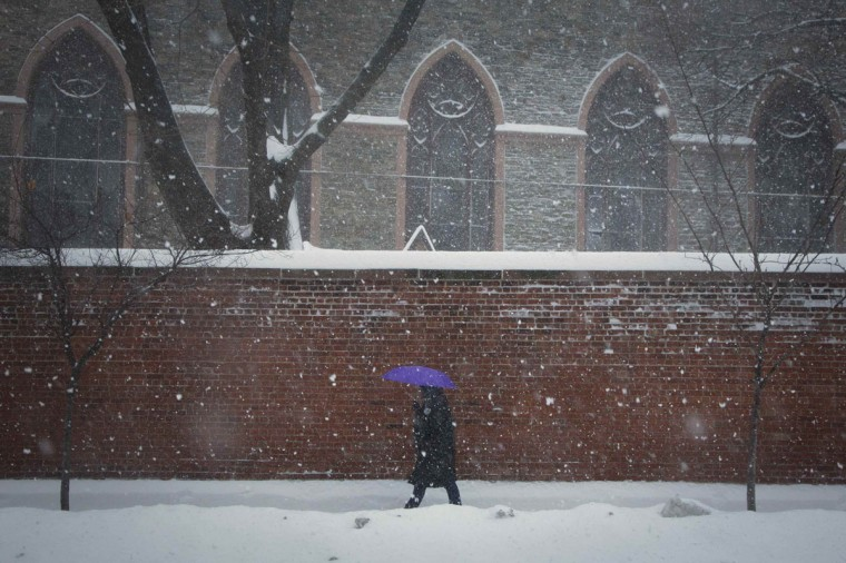 A commuter walks through through heavy snow in the SOHo district of Manhattan, New York. (REUTERS/Andrew Kelly)