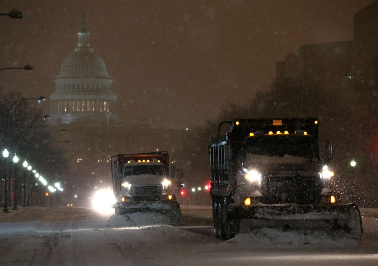 Snow plows push snow off of Pennsylvania Ave. near the U.S. Capitol building in Washington, DC. (Photo by Mark Wilson/Getty Images)