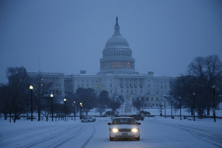 A police car sits at the entrance to a parking lot in the snow at the U.S. Capitol in Washington. (REUTERS/Jonathan Ernst)