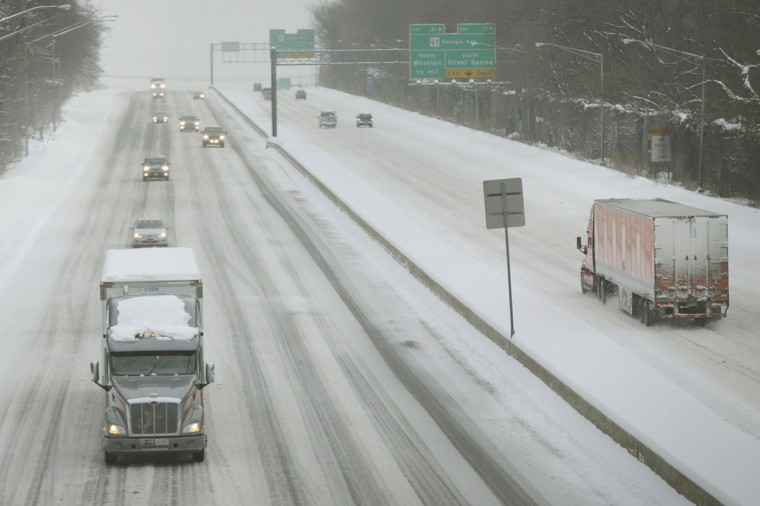 The Capital Beltway, normally observed with bumper to bumper morning commuter traffic, is seen during a snow storm in Silver Spring. (REUTERS/Gary Cameron)