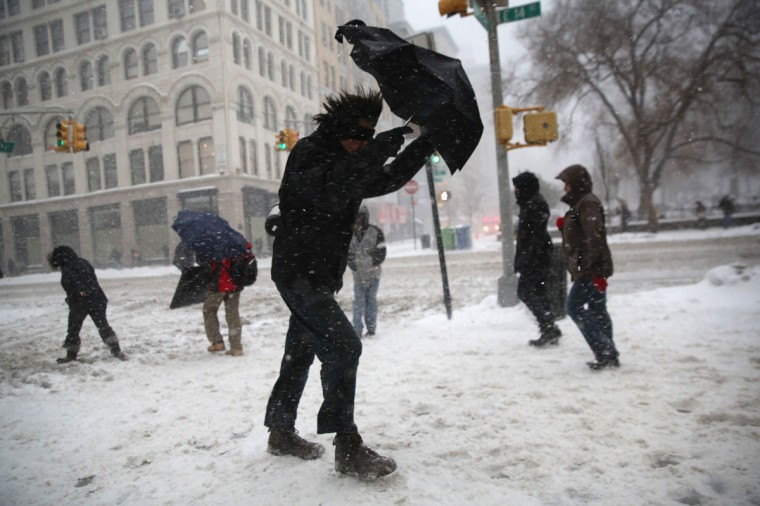 A man braces his umbrella while walking through the snow in New York City. (Photo by John Moore/Getty Images)