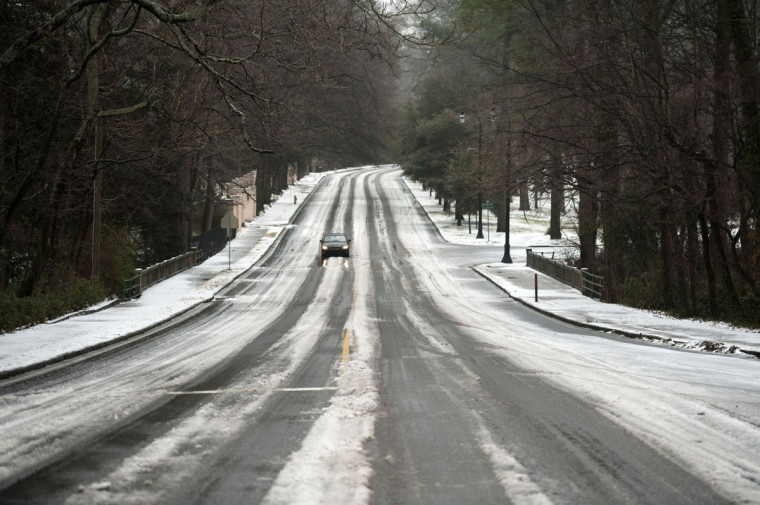 Hazardous driving conditions leave Ponce De Leo Avenue nearly deserted in Atlanta, Georgia. (Photo by Davis Turner/Getty Images)