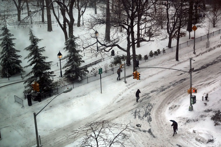 People walk through the snow in New York City. (Photo by Spencer Platt/Getty Images)
