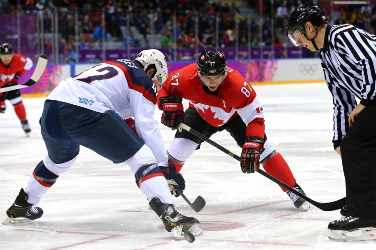 Sidney Crosby #87 of Canada faces off against David Backes #42 of the United States during the Men's Ice Hockey Semifinal Playoff on Day 14 of the 2014 Sochi Winter Olympics at Bolshoy Ice Dome on February 21, 2014 in Sochi, Russia. (Photo by Martin Rose/Getty Images)
