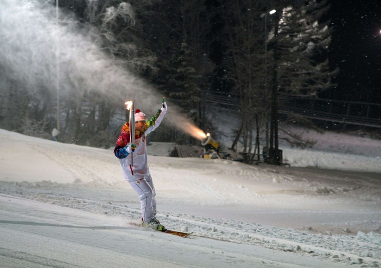 A handout picture taken during the Sochi 2014 Winter Olympic torch relay on November 25, 2013, and released by the Sochi 2014 Winter Olympics Organizing Committee shows a torchbearer skiing with his torch at a ski resort near the Siberian city of Krasnoyarsk, some 3500 km (2174 miles) east of Moscow. Russian torchbearers has started in October the history's longest Olympic torch relay ahead of Winter Games in Sochi, which will take the flame across the country through all 83 of its regions, including extreme locales such as Chukotka, the remote region in Russia's Far East, the turbulent North Caucasus, and even Russia's European exclave Kaliningrad. (Sochi 2014/Getty)
