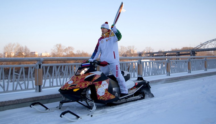 A handout picture taken during the Sochi 2014 Winter Olympic torch relay on December 11, 2013, and released by the Sochi 2014 Winter Olympics Organizing Committee shows a torchbearer riding with an Olympic torch in Russia's Siberian city of Tyumen 2144 km (1332 miles) east of Moscow. Russian torchbearers has started in October the history's longest Olympic torch relay ahead of Winter Games in Sochi, which will take the flame across the country through all 83 of its regions, including extreme locales such as Chukotka, the remote region in Russia's Far East, the turbulent North Caucasus, and even Russia's European exclave Kaliningrad. (Sochi 2014/Getty Images)