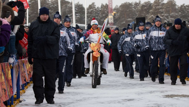 A handout picture taken during the Sochi 2014 Winter Olympic torch relay on December 17, 2013, and released by the Sochi 2014 Winter Olympics Organizing Committee shows a torchbearer riding a motorbike with an Olympic torch in Russia's Urals city of Chelyabinsk, 1500 km (932 miles) east of Moscow. Russian torchbearers has started in October the history's longest Olympic torch relay ahead of Winter Games in Sochi, which will take the flame across the country through all 83 of its regions, including extreme locales such as Chukotka, the remote region in Russia's Far East, the turbulent North Caucasus, and even Russia's European exclave Kaliningrad. (Sochi 2014/Getty Images)