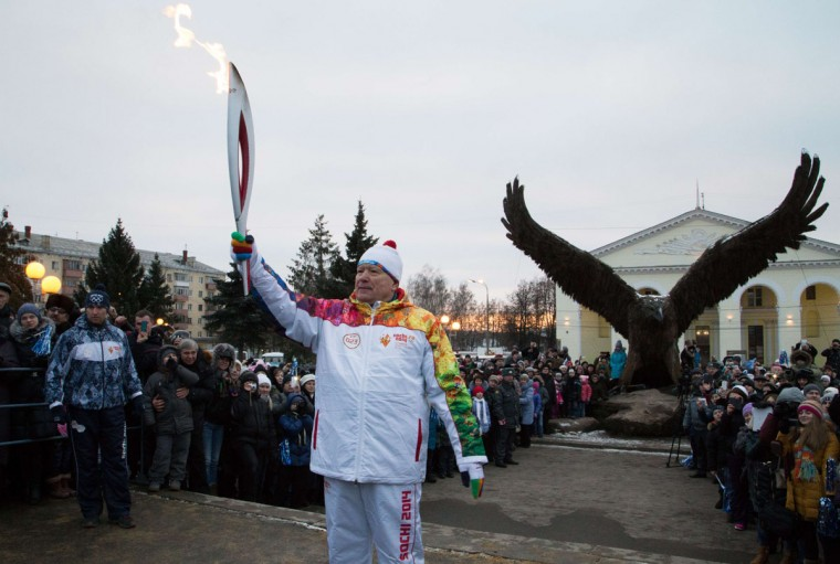A handout picture taken during the Sochi 2014 Winter Olympic torch relay on January 14, 2014, and released by the Sochi 2014 Winter Olympics Organizing Committee shows a torchbearer carrying an Olympic torch in the ancient Russian city of Oryol, some 360 km (220 miles) southwest of Moscow. Russian torchbearers has started in October the history's longest Olympic torch relay ahead of Winter Games in Sochi, which will take the flame across the country through all 83 of its regions, including extreme locales such as Chukotka, the remote region in Russia's Far East, the turbulent North Caucasus, and even Russia's European exclave Kaliningrad. (Sochi 2014/Getty Images)