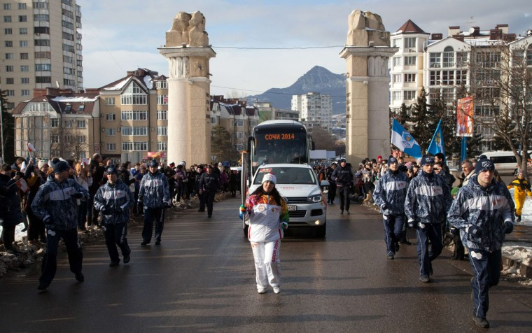 A handout picture taken during the Sochi 2014 Winter Olympic torch relay on January 23, 2014, and released by the Sochi 2014 Winter Olympics Organizing Committee shows a torchbearer carrying an Olympic torch in Russia's North Caucasus city of Pyatigorsk. Russian torchbearers has started in October 2013 the history's longest Olympic torch relay ahead of Winter Games in Sochi, which will take the flame across the country through all 83 of its regions, including extreme locales such as Chukotka, the remote region in Russia's Far East, the turbulent North Caucasus, and even Russia's European exclave Kaliningrad. (Sochi 2014/Getty Images)