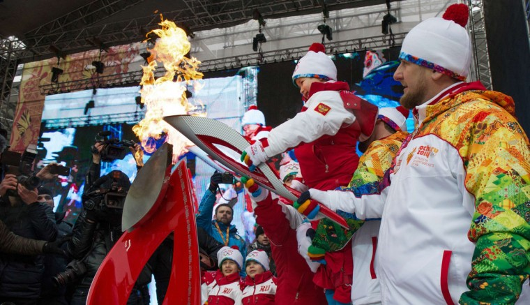 A handout picture taken during the Sochi 2014 Winter Olympic torch relay on January 28, 2014, and released by the Sochi 2014 Winter Olympics Organizing Committee shows Chechnya's leader Ramzan Kadyrov (R) helping a little boy to hold an Olympic torch during the torch relay in the Chechen capital Grozny. Russian torchbearers has started in October 2013 the history's longest Olympic torch relay ahead of Winter Games in Sochi, which will take the flame across the country through all 83 of its regions, including extreme locales such as Chukotka, the remote region in Russia's Far East, the turbulent North Caucasus, and even Russia's European exclave Kaliningrad. (Sochi 2014/Getty Images)