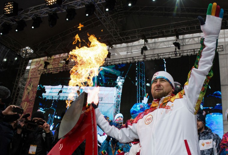 A handout picture taken during the Sochi 2014 Winter Olympic torch relay on January 28, 2014, and released by the Sochi 2014 Winter Olympics Organizing Committee shows Chechnya's leader Ramzan Kadyrov taking part in the torch relay in the Chechen capital Grozny. Russian torchbearers has started in October 2013 the history's longest Olympic torch relay ahead of Winter Games in Sochi, which will take the flame across the country through all 83 of its regions, including extreme locales such as Chukotka, the remote region in Russia's Far East, the turbulent North Caucasus, and even Russia's European exclave Kaliningrad. (Sochi 2014/Getty Images)