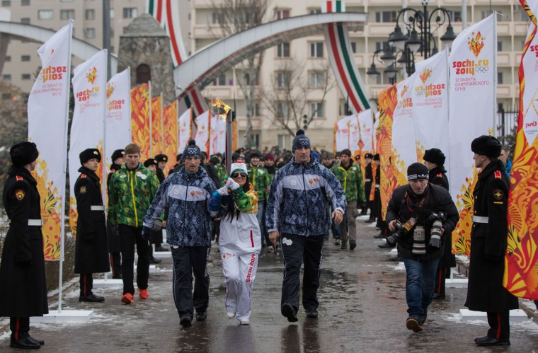 A handout picture taken during the Sochi 2014 Winter Olympic torch relay on January 28, 2014, and released by the Sochi 2014 Winter Olympics Organizing Committee shows blind singer Diana Gurtskaya carrying an Olympic torch in the Chechen capital Grozny. Russian torchbearers has started in October 2013 the history's longest Olympic torch relay ahead of Winter Games in Sochi, which will take the flame across the country through all 83 of its regions, including extreme locales such as Chukotka, the remote region in Russia's Far East, the turbulent North Caucasus, and even Russia's European exclave Kaliningrad. (Sochi 2014/Getty Images)