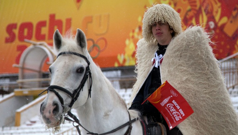 A handout picture taken during the Sochi 2014 Winter Olympic torch relay on January 30, 2014 and released by the Sochi 2014 Winter Olympics Organizing Committee, shows a horseman wearing traditional costume of Russia's North Caucasus region in Vladikavkaz, the capital of North Ossettia. Russian torchbearers has started in October 2013 the history's longest Olympic torch relay ahead of February's Winter Games in Sochi, which will take the flame across the country through all 83 of its regions, including extreme locales such as Chukotka, the remote region in Russia's Far East, the turbulent North Caucasus, and even Russia's European exclave Kaliningrad. (Sochi 2014/Getty Images)