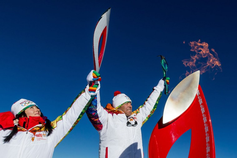 A handout picture taken during the Sochi 2014 Winter relay on October 25, 2013 and released by the Sochi 2014 Winter Olympics Organizing Committee, shows torchbearers carrying an Olympic torch at the Elbrus Mount in Russia's North Caucasus region. Russian torchbearers has started in October 2013 the history's longest Olympic torch relay ahead of February's Winter Games in Sochi, which will take the flame across the country through all 83 of its regions, including extreme locales such as Chukotka, the remote region in Russia's Far East, the turbulent North Caucasus, and even Russia's European exclave Kaliningrad. (Sochi 2014/Getty Images)