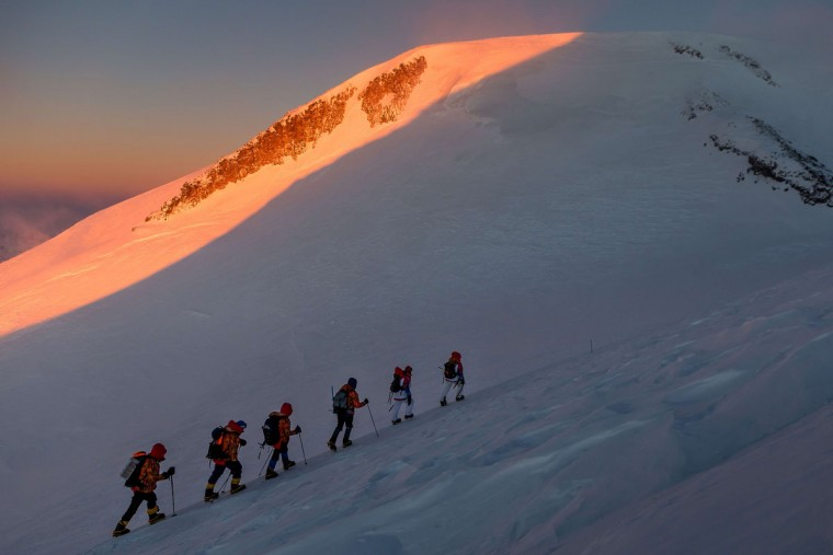 A handout picture taken during the Sochi 2014 Winter relay on October 22, 2013 and released by the Sochi 2014 Winter Olympics Organizing Committee, shows torchbearers carrying an Olympic torch to the Elbrus Mount in Russia's North Caucasus region. Russian torchbearers has started in October 2013 the history's longest Olympic torch relay ahead of February's Winter Games in Sochi, which will take the flame across the country through all 83 of its regions, including extreme locales such as Chukotka, the remote region in Russia's Far East, the turbulent North Caucasus, and even Russia's European exclave Kaliningrad. (Sochi 2014/Getty Images)