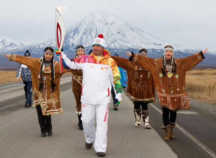 A handout picture taken during the Sochi 2014 Winter Olympic torch relay on November 12, 2013, and released by the Sochi 2014 Winter Olympics Organizing Committee shows a torchbearer carrying his torch at Russia's Pacific Kamchatka peninsula, some 6766 kilometers (4204 miles) east of Moscow. Russian torchbearers has started in October the history's longest Olympic torch relay ahead of Winter Games in Sochi, which will take the flame across the country through all 83 of its regions, including extreme locales such as Chukotka, the turbulent North Caucasus, and even Russia's European exclave Kaliningrad. (Sochi 2014/Getty Images)