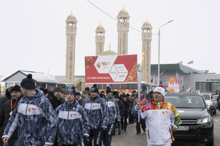 Torchbearer Muslim Khuchiev takes part in the Sochi 2014 Winter Olympic torch relay near a mosque in the Chechen capital Grozny, January 28, 2014. Sochi will host the 2014 Winter Olympic Games from February 7 to February 23. Picture taken January 28, 2014. (Sochi 2014/REUTERS)Torchbearer Muslim Khuchiev takes part in the Sochi 2014 Winter Olympic torch relay near a mosque in the Chechen capital Grozny, January 28, 2014. Sochi will host the 2014 Winter Olympic Games from February 7 to February 23. Picture taken January 28, 2014. (Sochi 2014/REUTERS)