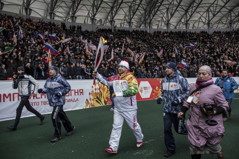 Chechen President Ramzan Kadyrov (C) takes part in the Sochi 2014 Winter Olympic torch relay in the Chechen capital Grozny, January 28, 2014. Sochi will host the 2014 Winter Olympic Games from February 7 to February 23. Picture taken January 28, 2014. (Sochi 2014/REUTERS)
