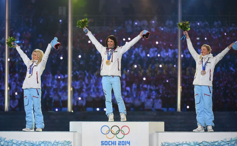 From left, Norway's silver medalist Therese Johaug, Norway's gold medalist Marit Bjoergen and Norway's bronze medalist Kristin Stoermer Steira pose on the podium during the Women's Cross-Country Skiing 30km Mass Start Free Medal Ceremony at the Closing Ceremony of the Sochi Winter Olympics. (DAMIEN MEYER/AFP/Getty Images)