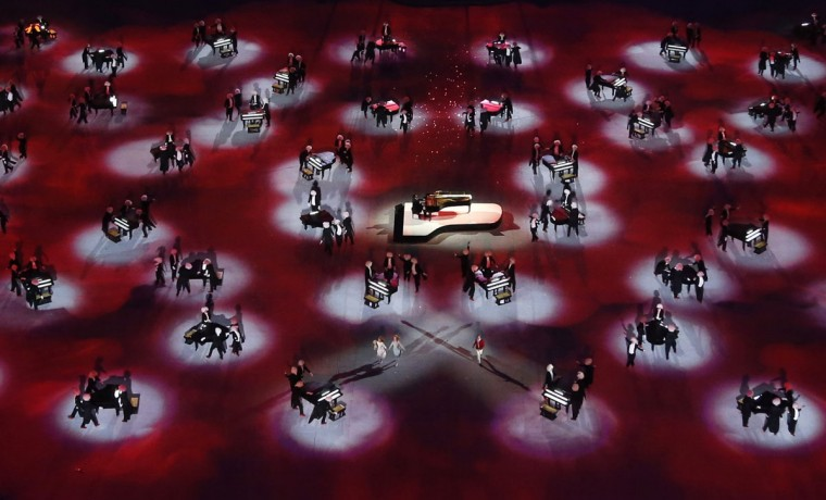 Russian pianist Denis Matsuev (center) performs during the closing ceremony for the 2014 Sochi Winter Olympics. (REUTERS/Pawel Kopczynski)