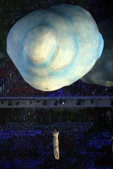 A performer floats across the arena during the 2014 Sochi Winter Olympics Closing Ceremony at Fisht Olympic Stadium. (Photo by Doug Pensinger/Getty Images)