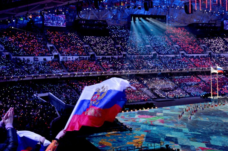 The Russian flag is waved from the stands during Closing Ceremony of the Sochi Winter Olympics at the Fisht Olympic Stadium. (ANDREJ ISAKOVIC/AFP/Getty Images)