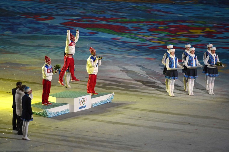 From left, Russia's silver medalist Maxim Vyleghzanin, Russia's gold medalist Alexander Legkov and Russia's bronze medalist Ilia Chernousov pose on the podium during the Men's Cross-Country Skiing 50km Mass Start Free Victory Ceremony at the Closing Ceremony of the Sochi Winter Olympics. (ANDREJ ISAKOVIC/AFP/Getty Images)