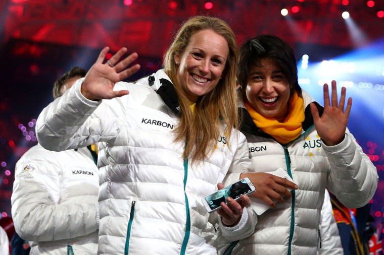 Skelton athlete Lucy Chaffer (left) and snowboarder Belle Brockhoff of Australia enter during the 2014 Sochi Winter Olympics Closing Ceremony at Fisht Olympic Stadium. (Photo by Paul Gilham/Getty Images)