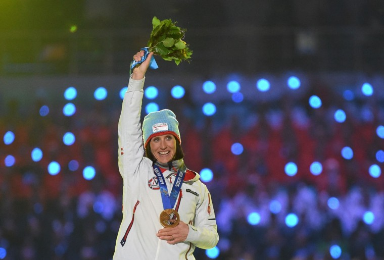 Norway's gold medalist Marit Bjoergen celebrates on the podium during the Women's Cross-Country Skiing 30km Mass Start Free Medal Ceremony at the Closing Ceremony of the Sochi Winter Olympics. (DAMIEN MEYER/AFP/Getty Images)